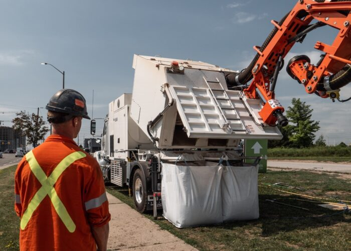 Dry-Vac-City-Dino-dumping-dry-material-into-bags